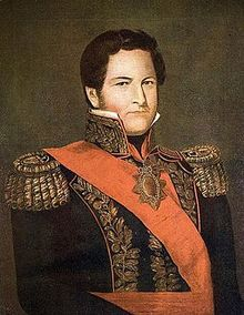Painting of the head and shoulders of a man in 19th century military garb with ornate epaulettes and sash. He is looking at the viewer.