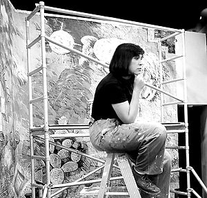 "Judithe Hernández - 1981 – Judithe Hernández painting at the ""Murals of Aztlan exhibition, CAFAM, Los Angeles, CA"