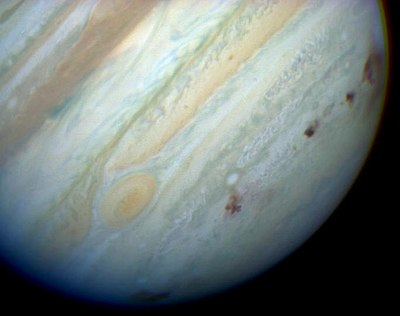 Brown spots mark impact sites of the Shoemaker-Levy Comet on Jupiter's southern hemisphere. Jupiter showing SL9 impact sites.jpg