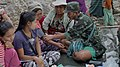 KNLA medic treating displaced civilians (Steve Sandford-VOA).jpg