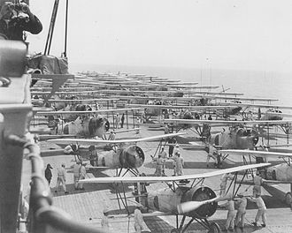 Japanese aircraft carrier Kaga - Kaga conducts air operations in 1937. On deck are Nakajima A2N, Aichi D1A, and Mitsubishi B2M aircraft.