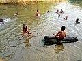 Kids swimming in the creeks.jpg
