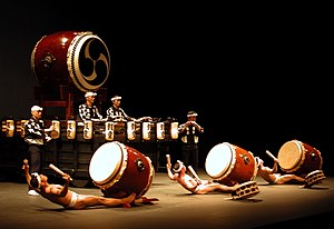 Kodō (taiko group) - A 2007 performance of the piece Yatai-bayashi during the ending of the piece.  The three performers in front playing chu-daiko are wearing fundoshi.