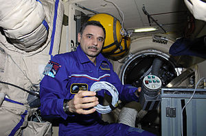 Mikhail Kornienko - Kornienko services the Russian Bioemulsion experiment in the Pirs Docking Compartment.