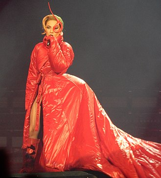 """Joanne World Tour - Gaga during the performance of """"Bloody Mary"""". The red costume was noted for """"bringing back the avant garde looks"""" that have been characteristic of her."""