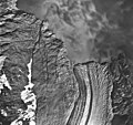 Lamplugh Glacier, tidewater glacier with medial moraine and glacial flour in the water, August 25, 1968 (GLACIERS 5582).jpg