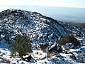 Lava rocks with snow (356543801).jpg