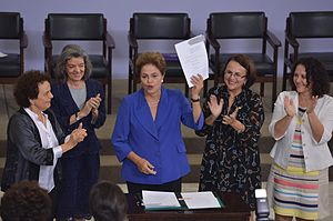 Domestic violence in Brazil - Dilma Roussef, former president of Brazil signs the feminicide law.