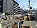 Level crossing in front of Sasabaru Station.JPG