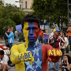 Human rights in Venezuela - Protester with Libertad written on his fingers.