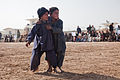 Local boys wrestle, outside of the Zhari District Center, Kandahar province, Afghanistan, Dec. 24, 2011 111224-A-VB845-058.jpg