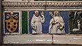 Luca della robbia il giovane, deposizione dalla croce e compianto, 1515 ca. 04 stemma medici e due santi.jpg