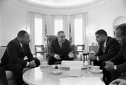 Meeting with civil rights leaders Rev. Martin Luther King Jr. (left), Whitney Young, and James Farmer in the Oval Office in 1964 Lyndon Johnson meeting with civil rights leaders.jpg