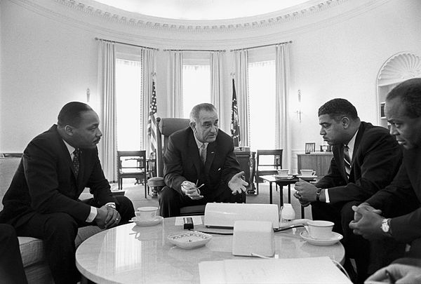President Lyndon B. Johnson (center) meets with civil rights leaders Martin Luther King Jr., Whitney Young, and James Farmer, January 1964 Lyndon Johnson meeting with civil rights leaders.jpg