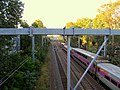 MBTA Commuter Rail train passing former Mount Hope station site, September 2016.JPG