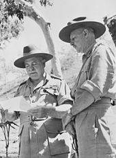 Two soldiers in khaki uniforms and slouch hats.