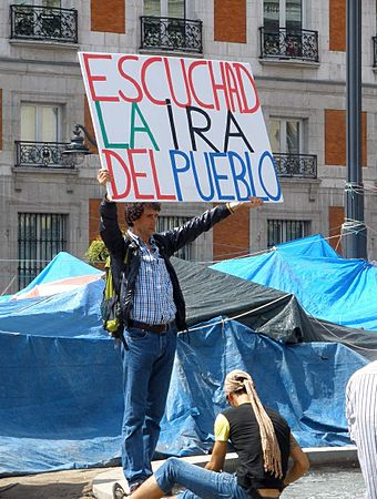 """Hear the wrath of the people,"" a member of the Indignados, a Spanish left-wing populist movement, in Puerta del Sol Madrid - Acampada Sol 2011 43.JPG"