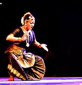 Photograph of a dancer wearing black Sari.