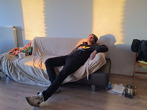 Leisure - A man relaxing on a couch