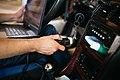 Man holding Obd2 jack for car software diagnostic.jpg