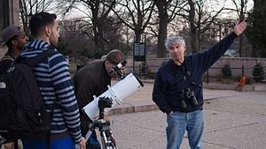 Public science - Man in Brooklyn's Prospect Park inviting passersby to use his telescope and talk about an astronomical phenomenon.