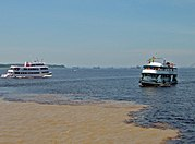 "The ""Meeting of Waters"" is the confluence of the Rio Negro (black) and the Rio Solimões (sandy) near Manaus, Brazil."