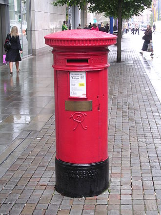 Corporation Street, Manchester - A pillar box, near the top of Corporation Street, the only structure in the area that survived the 1996 bomb. The bombing is commemorated with a brass plaque.