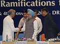 """Manmohan Singh being welcomed by the Chief Information Commissioner, Shri Wajahat Habibullah at the inauguration of the third Annual Convocation-2008 on """"RTI and its Ramifications for Good Governance"""", in New Delhi.jpg"""