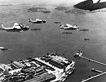 Martin PBM-3S Mariners of VPB-211 fly over Rio de Janeiro, in December 1943 (NH 94610).jpg