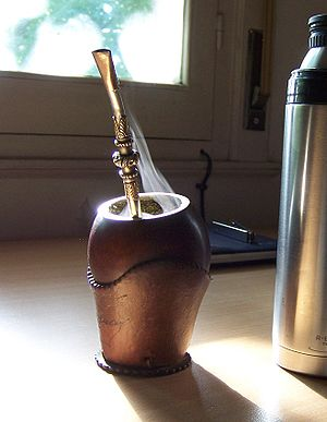 Yerba mate - Steaming mate infusion in its customary cup that resembles the shape of a gourd, the customary vessel