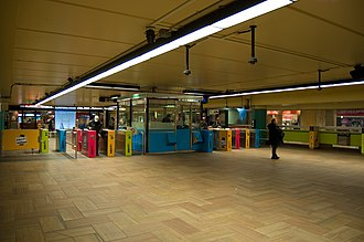 McGill station - McGill station concourse.(The previous green coloured pillars can be seen in the background)