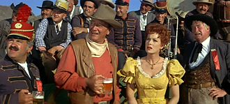 Jack Kruschen - Front row, from left to right: Jack Kruschen, John Wayne, Maureen O'Hara and Chill Wills in McLintock!