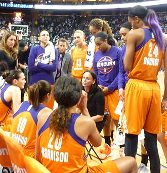 Phoenix Mercury - Coaches Julie Hairgrove, Todd Troxel (left to right) and head coach Sandy Brondello (seated) in a timeout during the 2016 WNBA semifinals.