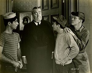 East Side Kids - Bobby Stone, Robert Greig, Leo Gorcey, and Huntz Hall in the film Million Dollar Kid (1944).