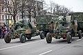 Ministru prezidents Valdis Dombrovskis vēro Nacionālo bruņoto spēku vienību militāro parādi 11.novembra krastmalā (8196546880).jpg