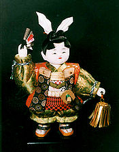 Bisque doll of Momotarō,a character from Japanese literature and folklore.