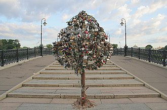 Love lock - One of many purpose-built iron trees on a bridge across the Vodootvodny Canal in Moscow completely covered in love padlocks.