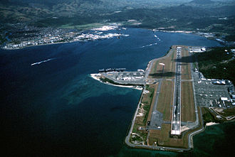 U.S. Naval Base Subic Bay - An aerial view of Cubi Point, and in the background, Naval Station Subic Bay.