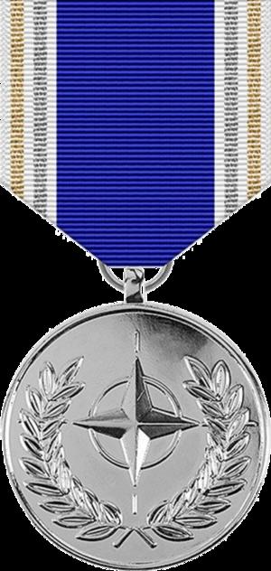 NATO Medal - Image: NATO Meritorious Service Medal, obverse