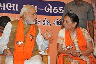 Narendra Modi - Modi with Anandiben Patel at a meeting of BJP MLAs after his election as prime minister; Patel succeeded him as Gujarat chief minister.