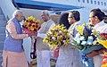 Narendra Modi being welcomed by the Governor of Karnataka, Shri Vajubhai Rudabhai Vala, the Chief Minister of Karnataka, Shri Siddaramaiah and the Union Minister for Law & Justice, Shri D.V. Sadananda Gowda on his arrival.jpg