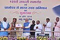 """Narendra Modi presenting the credit certificates, under various schemes to the beneficiaries from Scheduled Casts, at the launching ceremony of the """"Gram Uday se Bharat Uday"""" Abhiyan, in Mhow, Madhya Pradesh (1).jpg"""