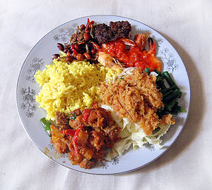 Urap - Urap (bottom right) as part of a nasi kuning dish.