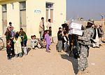 National Guardsmen distribute school supplies DVIDS342537.jpg
