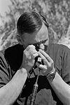 Neil examines a rock sample during the Sierra Blanca trip.jpg