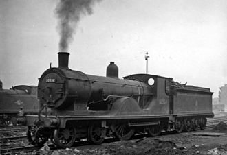 LSWR T9 class - No. 30338 came from the second series with wider splashers. Nine Elms depot 1958
