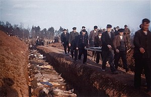 Mass grave - Workers from the town of Nordhausen bury corpses found at Mittelbau-Dora concentration camp. Rare colour photograph taken in 1945.