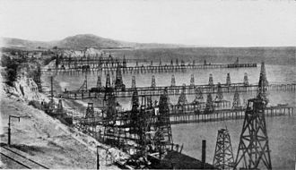 Petroleum reservoir - An oil field with dozens of wells.  This is the Summerland Oil Field, near Santa Barbara, California, before 1906