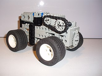 Lego Technic - A construction using the old pieces with studs.