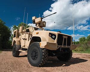 Orbital ATK - 2016 Oshkosh L-ATV (configured as a JLTV) equipped with EOS R-400S-MK2 remote weapon system integrated with Orbital ATK's M230-LF 30 mm lightweight automatic chain gun.
